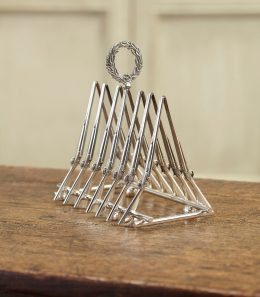 SILVER CROSSED GUNS TOAST RACK (925)